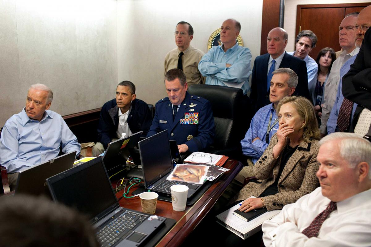 In this May 1, 2011 file image released by the White House and digitally altered by the source to diffuse the paper in front of Secretary of State Hillary Rodham Clinton, President Barack Obama and Vice President Joe Biden, along with with members of the