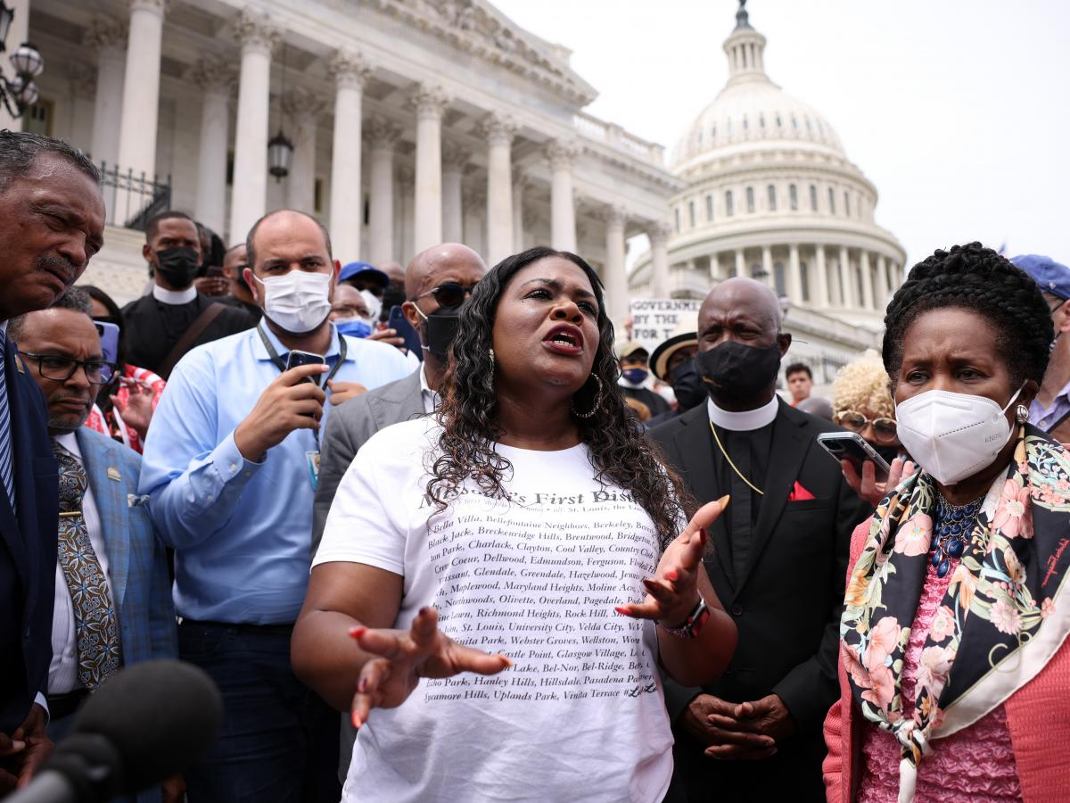 Rep. Cori Bush, D-Mo., (center) speaks at a rally at the U.S. Capitol on Tuesday. Bush slept on the steps of the Capitol for days to protest that the CDC's eviction moratorium was being allowed to expire.