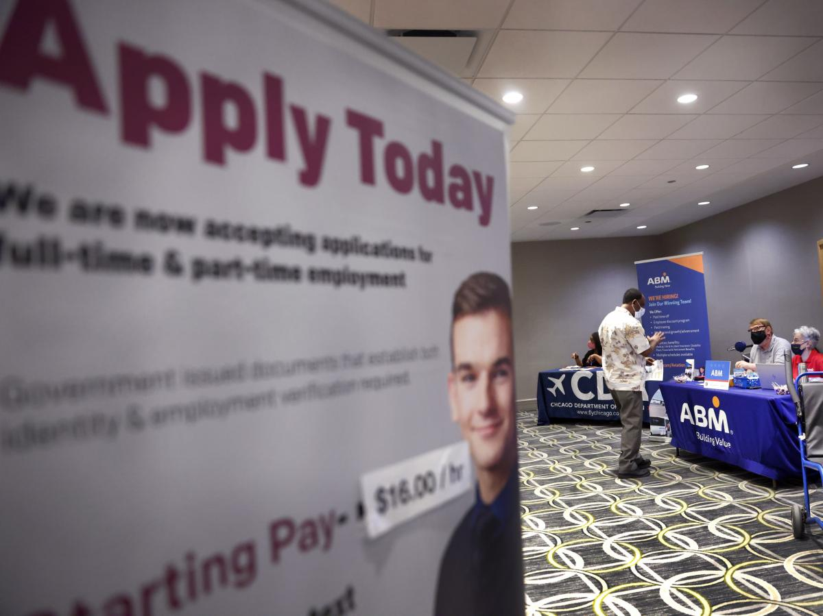 Recruiters looking to fill positions at O'Hare International Airport meet with candidates during a job fair at the Chicago airport on May 19. Hiring was expected to have picked up last month, providing a shot of relief to an economy in need of workers as
