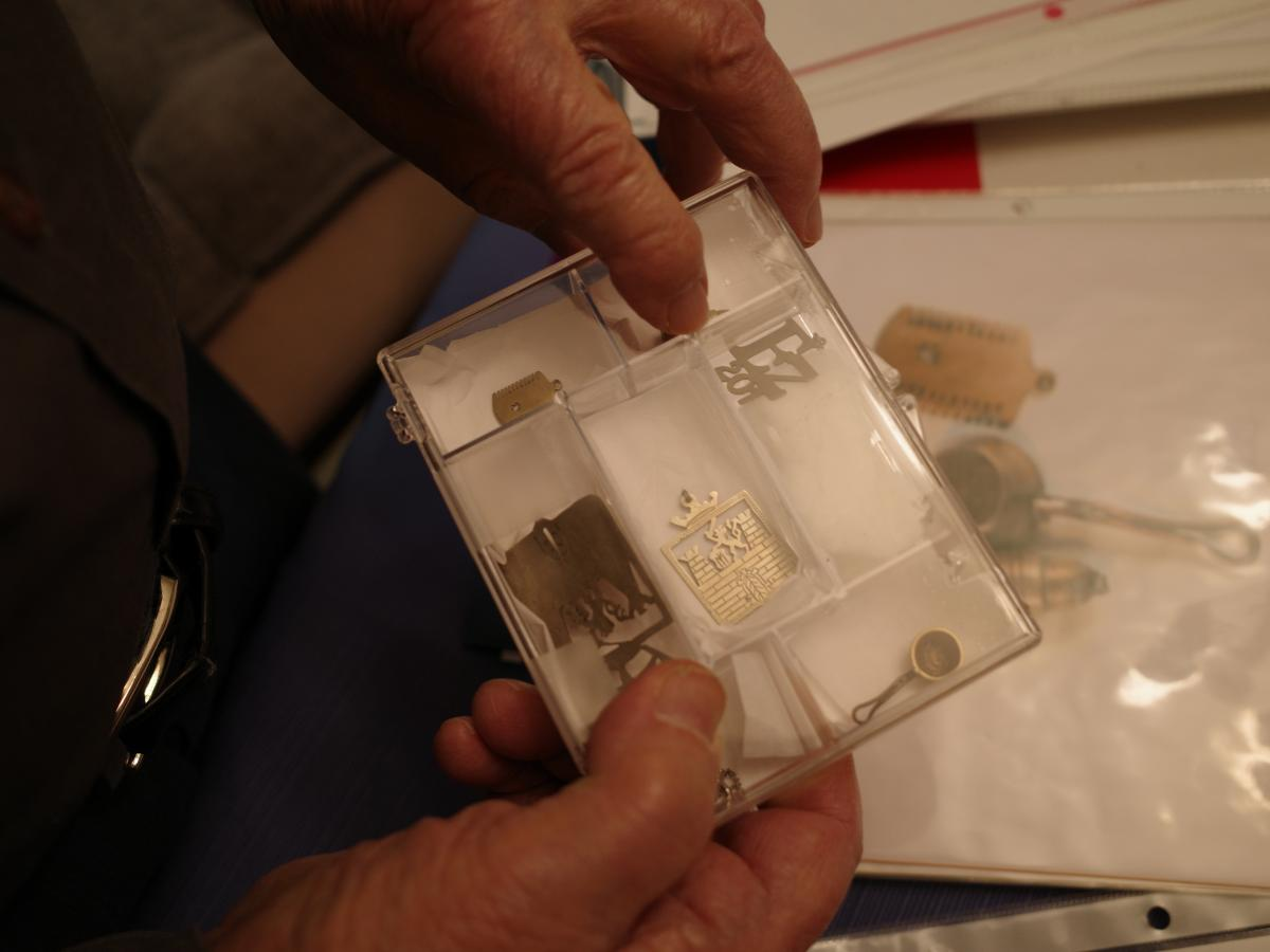 Vladimir Munk has saved jewelry he had made inside Terezin, a concentration camp north of Prague. He says the most popular was item was Terezin's coat of arms, center, which he had made for a girl he met there named Kitty, who would later become his wife