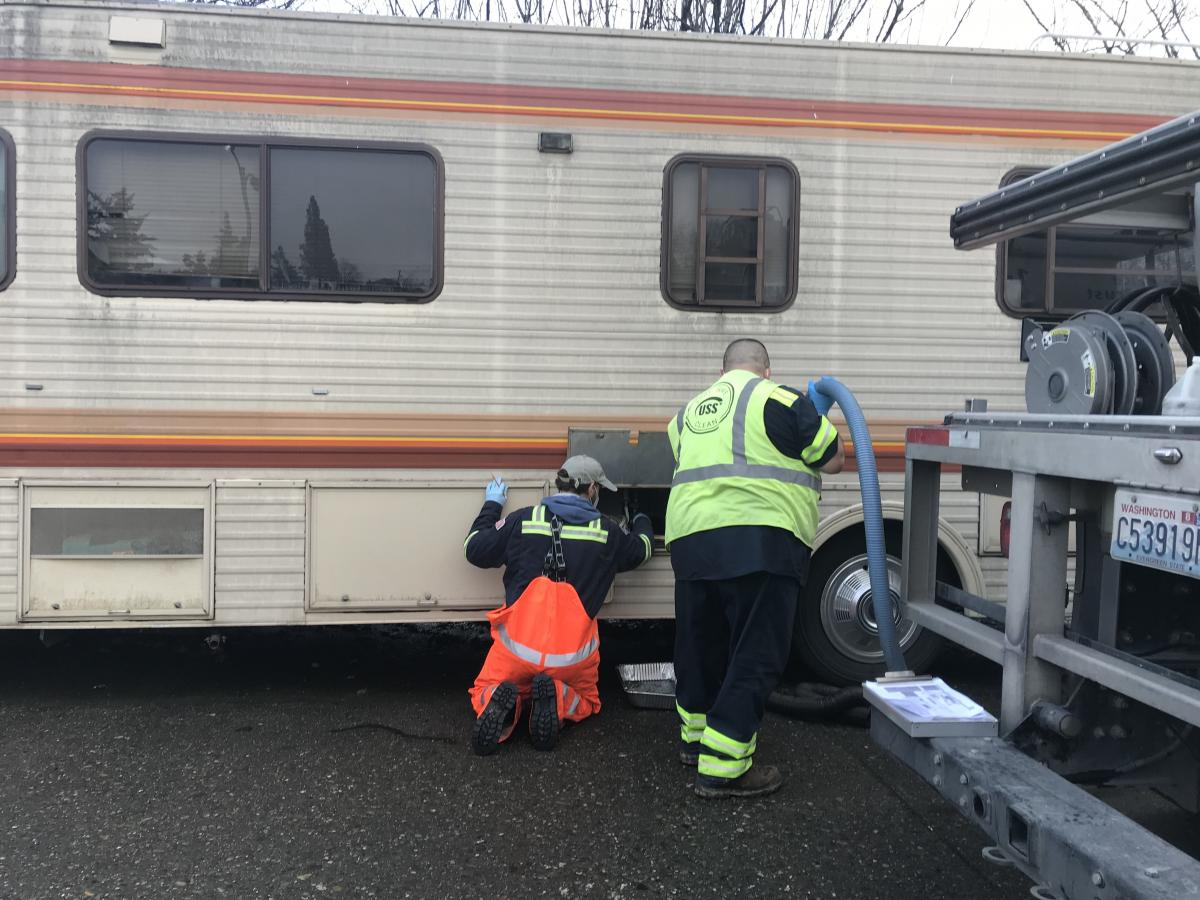 With the help of a contractor, Chris Wilkerson makes monthly visits to RVs and motor homes around the city that don't have access to dumping stations.