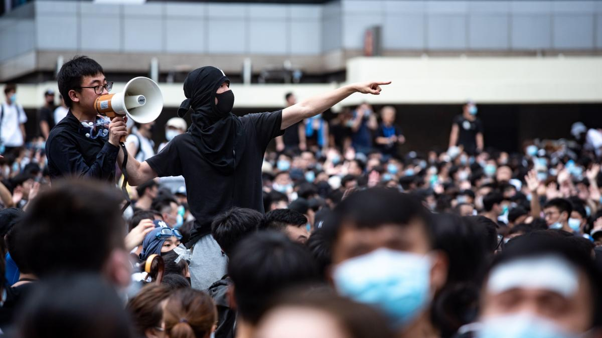 Protesters occupy the roads near the Legislative Council and government headquarters in Hong Kong on Wednesday as Hong Kong authorities delayed the second reading of a controversial bill allowing extradition to mainland China.