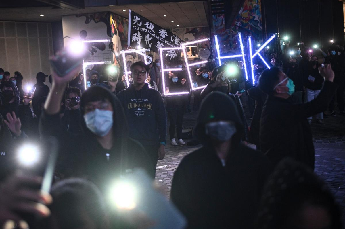 "Students gather for a demonstration Friday in the Tsim Sha Tsui district of Hong Kong, where they raised a ""Free HK"" light installation and sang ""Glory to Hong Kong"" in support of the protest movement."