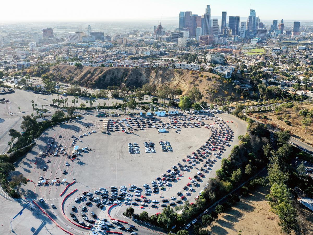 Cars line up at Dodger Stadium for coronavirus testing on the Monday after Thanksgiving weekend, Nov. 30, 2020, in Los Angeles.