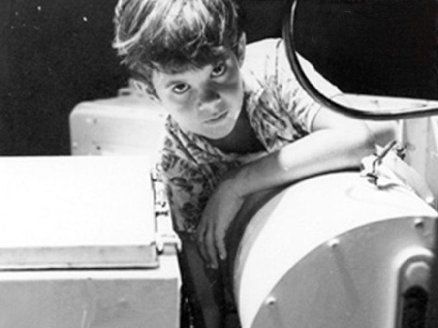 Ten-year-old Greg Force in 1969, greasing the antenna bearing at the NASA tracking station in Guam.