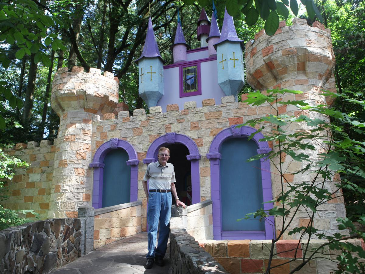 Roger Tofte in front of his first creation, the Castle, at the Enchanted Forest in Turner, Ore.