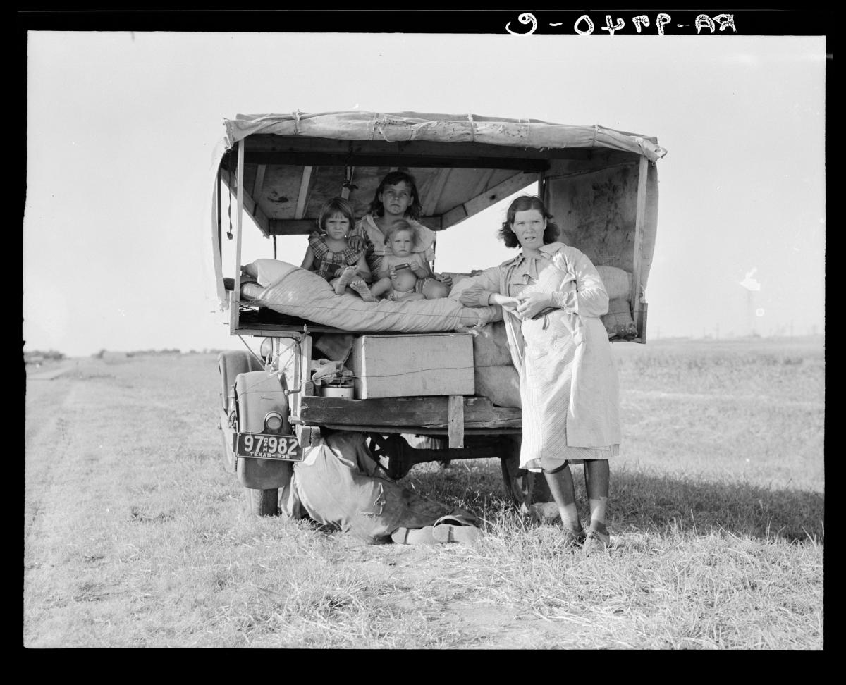"""A family traveling between Dallas and Austin, Texas. """"The people have left their home and connections in South Texas, and hope to reach the Arkansas Delta for work in the cotton fields,"""" Lang wrote in her notes. """"Penniless people. No food and three gallon"""