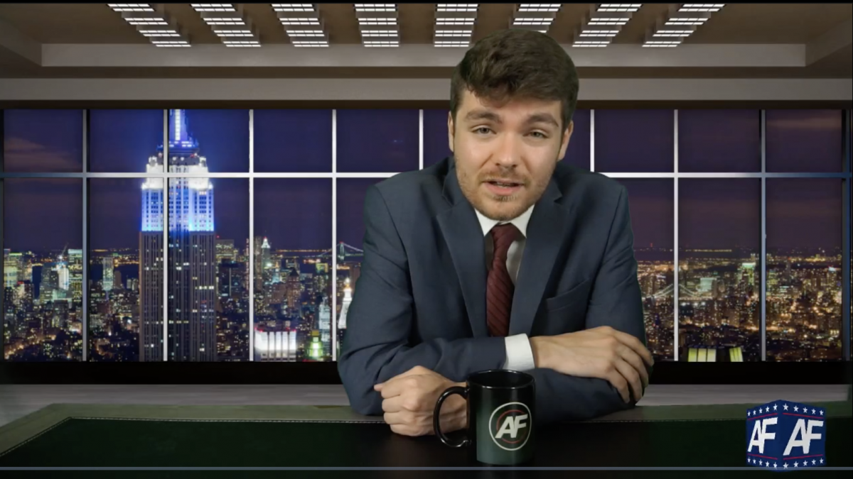 """Far-right extremist Nick Fuentes, seen here in a screenshot from his livestreamed show, has said he uses irony because it provides """"plausible deniability"""" and cover for some of his most incendiary statements."""