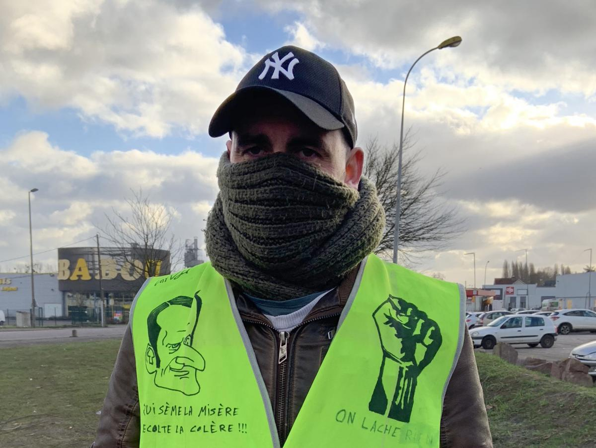 A yellow vest protester at a traffic circle in northern France's Normandy region.