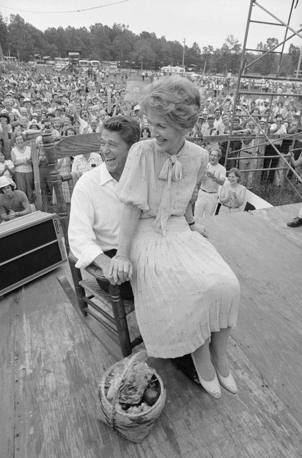 Republican presidential nominee Ronald Reagan and wife Nancy share a rocking chair presented to them during their visit to the Neshoba County Fair in Mississippi. The Reagans' visit marked the first time a major party nominee had ever addressed the fair.