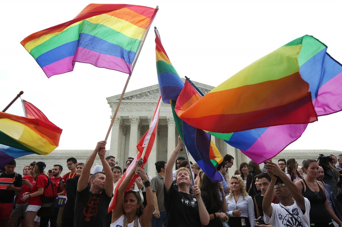 Same-sex marriage supporters rejoice after the U.S Supreme Court hands down a ruling regarding same-sex marriage outside the Supreme Court in Washington on June 26, 2015.