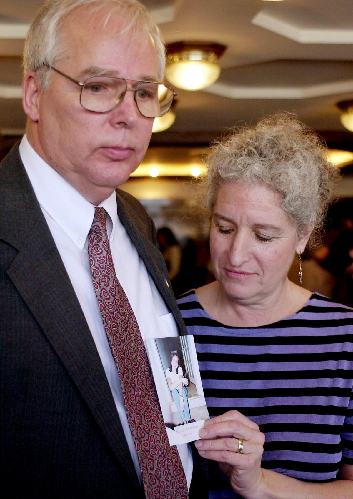 Ben Wainio and his wife Esther Heymann show a photo of their daughter, Honor Elizabeth Wainio, who was killed on United Flight 93.