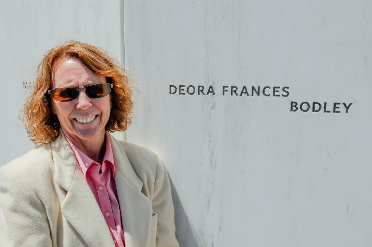Debby Borza stands next to her daughter's name at the Flight 93 Memorial. She says the space feels like a second home.