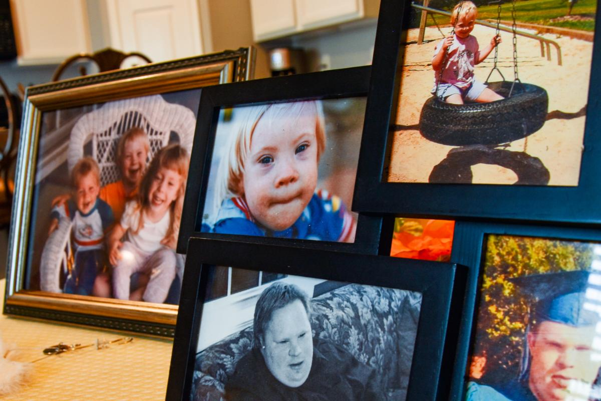 Photos of Ethan Saylor are displayed on his mother's kitchen table.