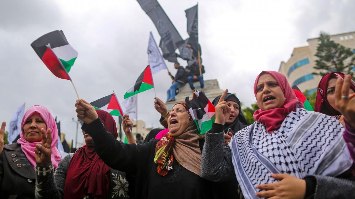 Palestinian women shout in protest during a mass demonstration in Gaza City on Wednesday.