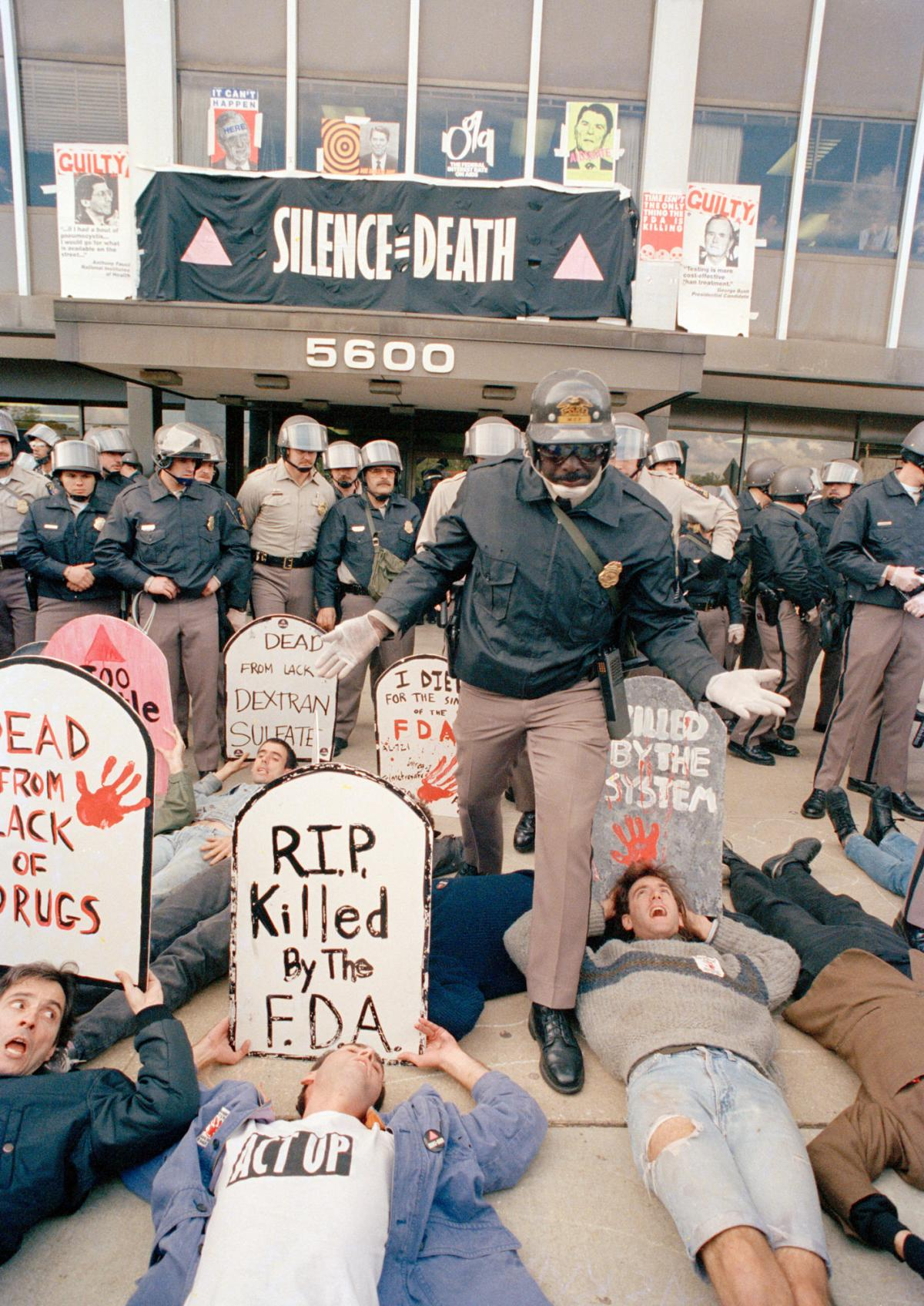 Demonstrators from the organization ACT UP protest in front of the headquarters of the Food and Drug Administration. The FDA opened up access to experimental drugs soon after.
