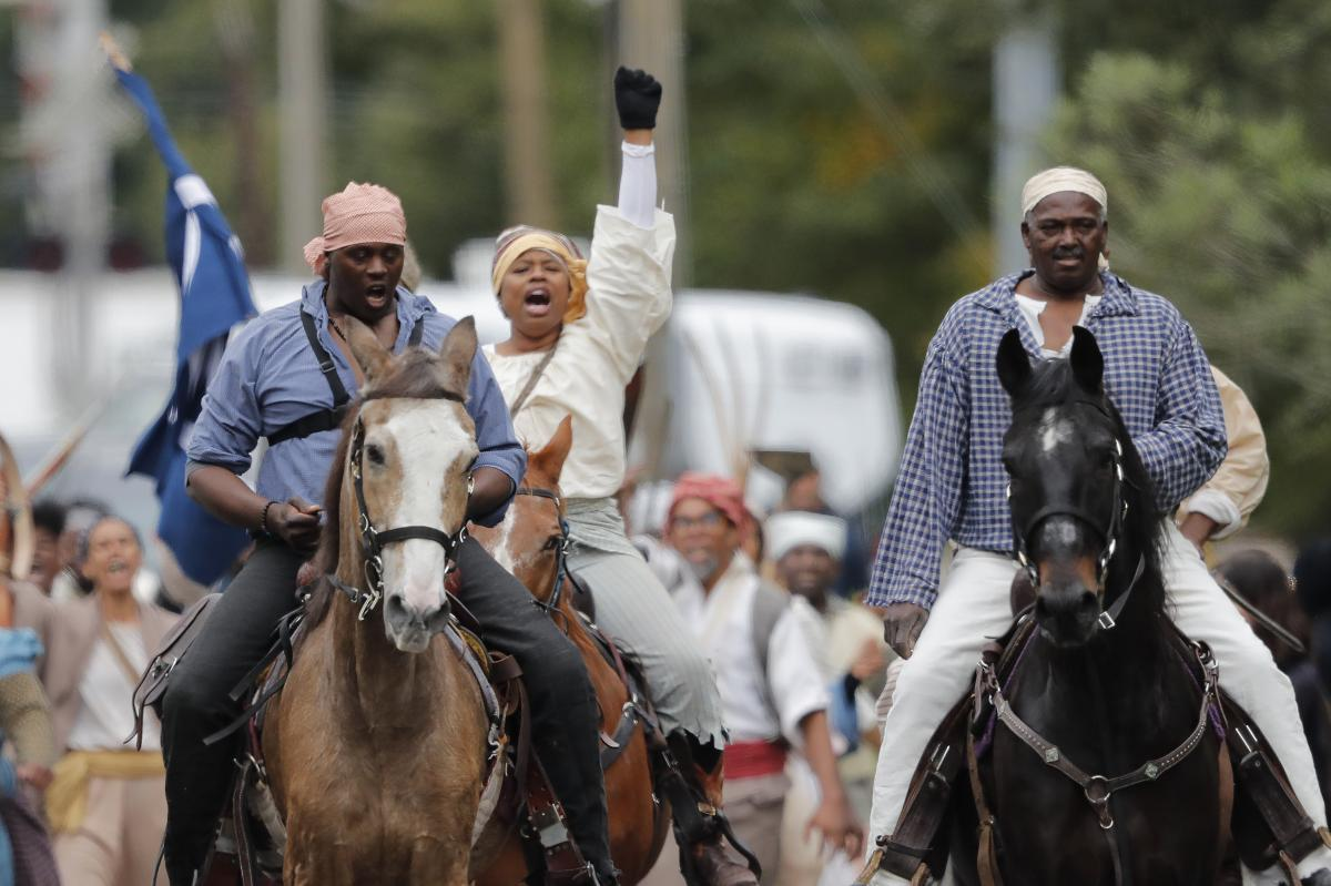 Volunteers participate in a reenactment of what is thought to be the largest slave rebellion in U.S. history in LaPlace, La., on Friday.