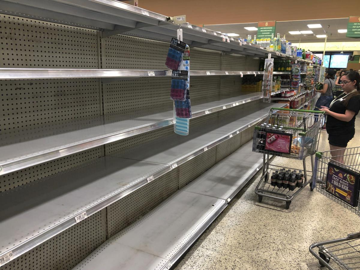 Store shelves in Doral, Fla., are empty of bottled water as residents buy supplies in preparation for Hurricane Dorian. The U.S. National Hurricane Center says Dorian is expected to hit the Florida coast over the weekend.