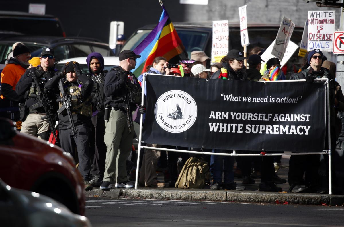Members of the Puget Sound John Brown Gun Club provide security to counterprotesters at a far-right rally in Seattle on Jan. 5.