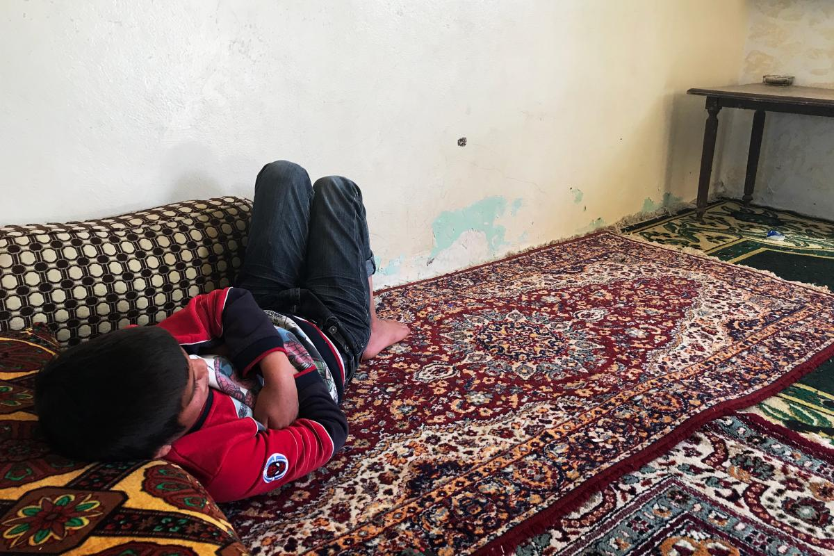 Haval, 12, watches TV. The Yazidi boy was rescued from the al-Hol camp and is waiting to be reunited with an older sister in the Sinjar region of Iraq.