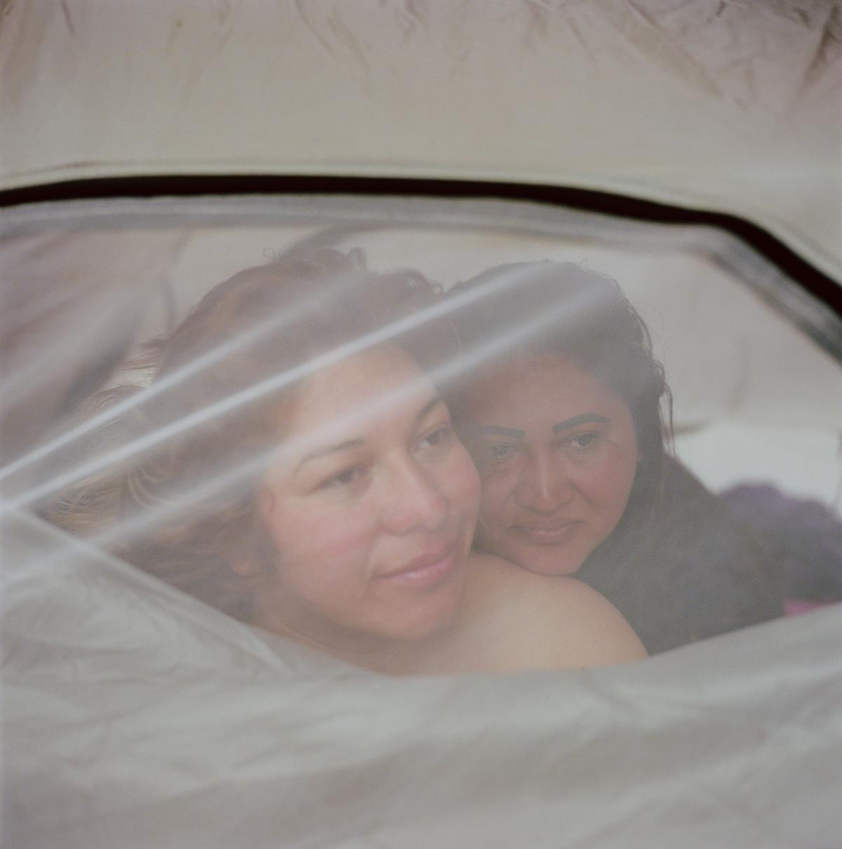 """Mirna Yolanda Contreras, 29 (left), and Paula Arita, 32, are both from San Pedro Sula, Honduras. """"Since we met in Puebla [Mexico], we have never separated. We became very good friends; we slept in the same place the whole time,"""" Contreras said."""