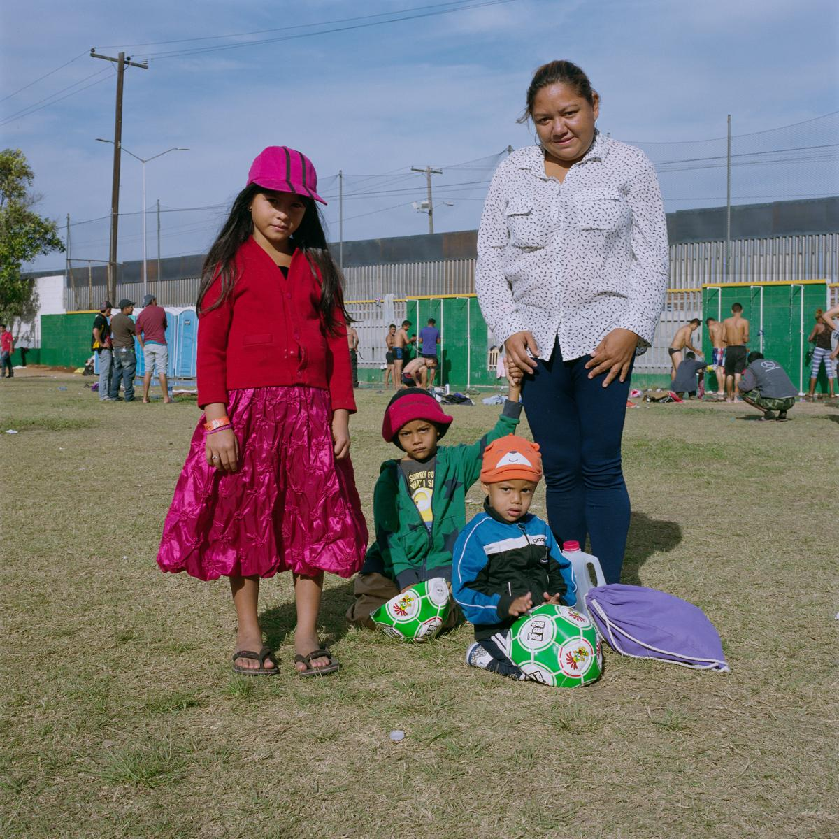 """Cynthia Carolina Soriano, 30, Kenneth Soriano, 2 (bottom right), Joseph Soriano, 5 (center), and Jennifer Soriano, 7 (left), from Villa Nueva Cortes, Honduras. """"The maltreatment I was subjected to, as other women there in Honduras, was why I decided to le"""