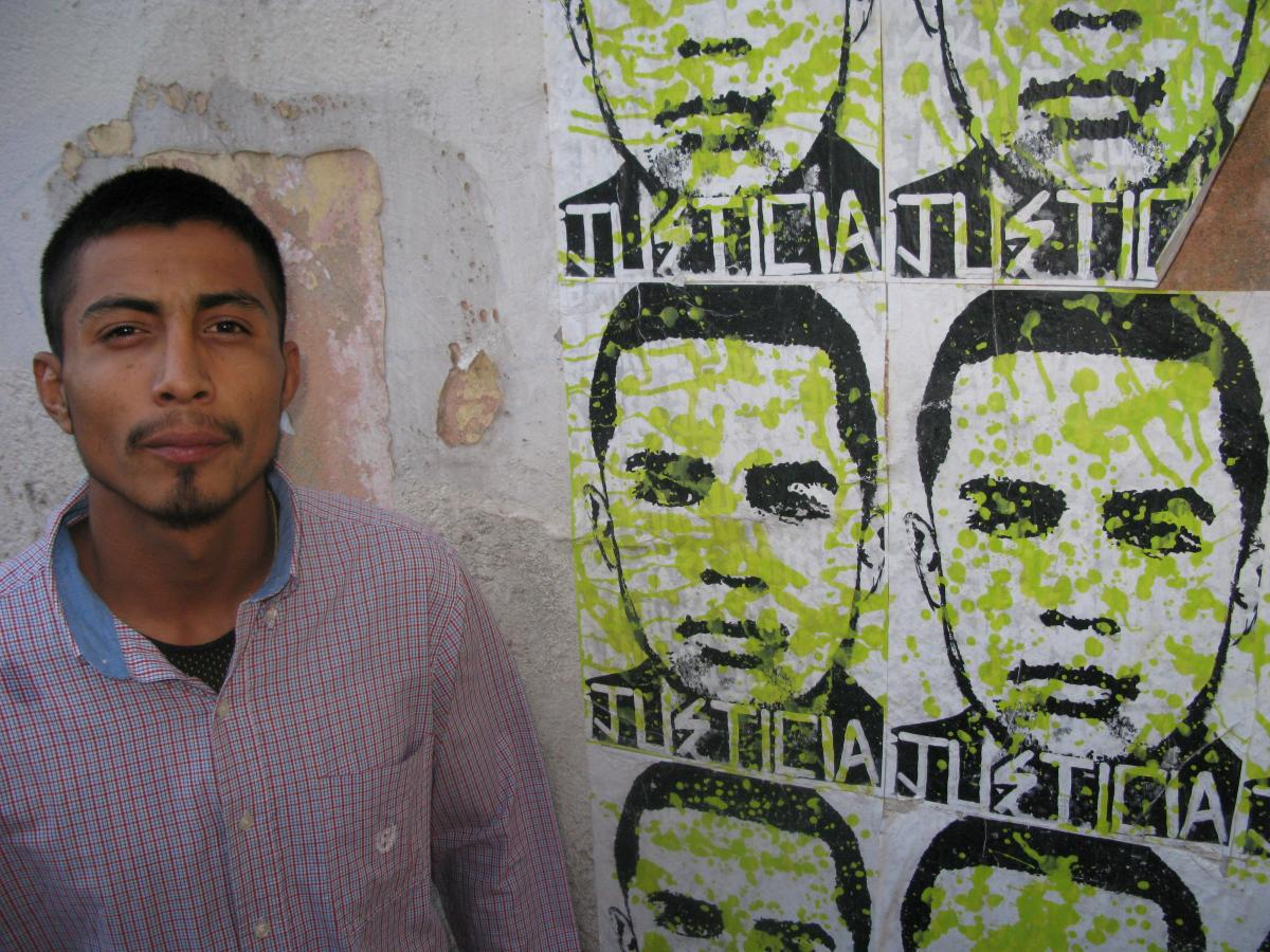 Diego next to posters of his brother Jose. The agent involved in Jose's death will be the first ever charged with murder for a cross-border shooting.