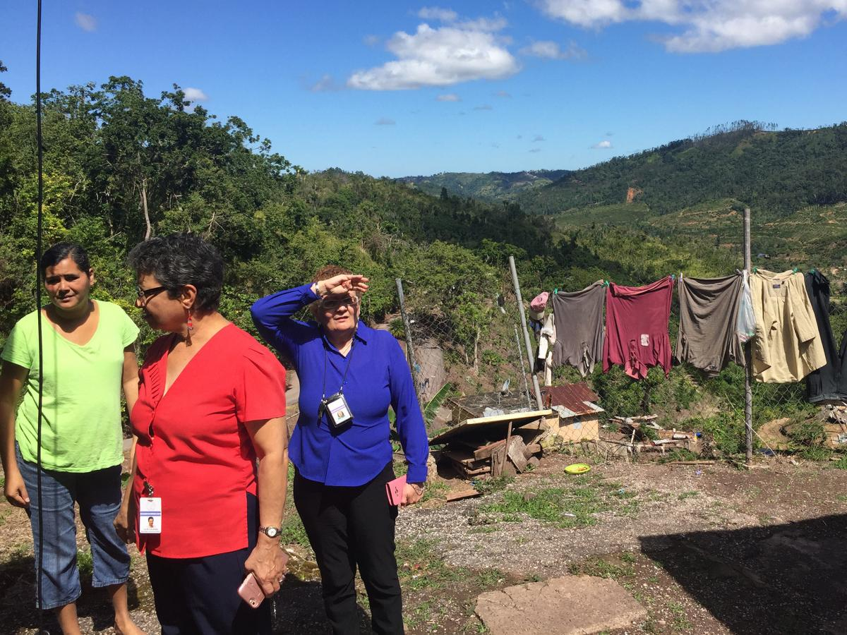 In front of Johanna Garcia Mercado's home in Castañer, the hillside collapsed during the hurricane. Since then, Mercado (left) has had panic attacks and finds herself crying uncontrollably. She has been seeing a psychologist at the local hospital and a s
