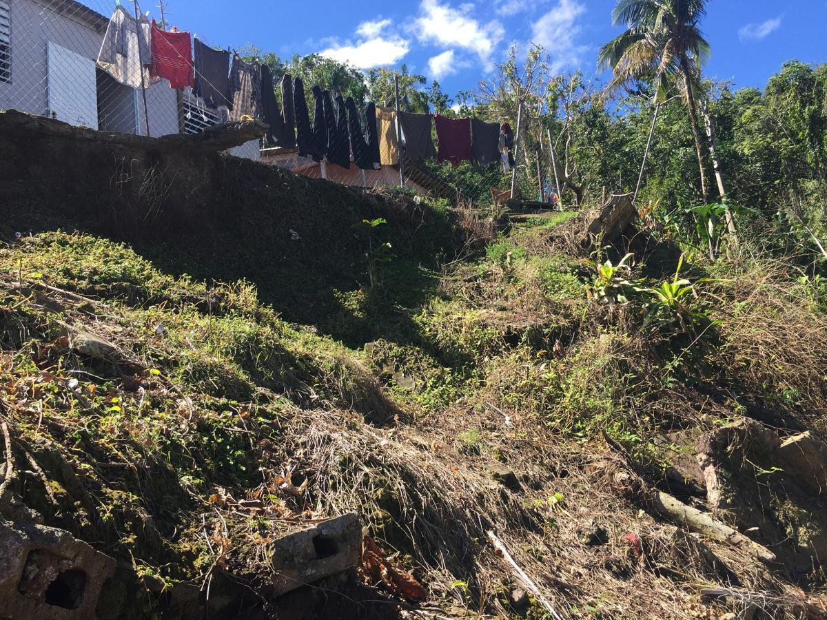 The hillside collapsed to within 10 feet of Mercado's front door during Hurricane Maria, and she was hospitalized for a month afterward. She and her husband still have nightmares with every storm.