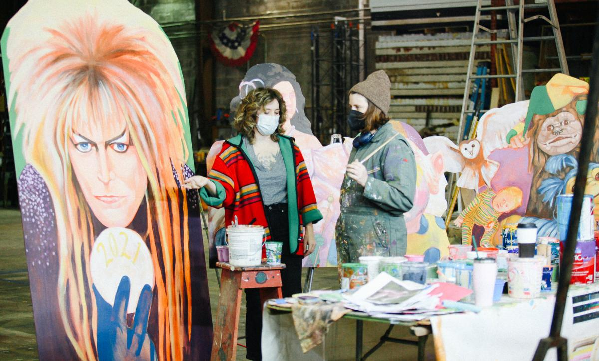 House floats are floating artists an economic life raft during the COVID pandemic. Coco Darrow (L) and Maddie Stratton (R) work on Mardi Gras decorations at The Stronghold Studios in New Orleans.