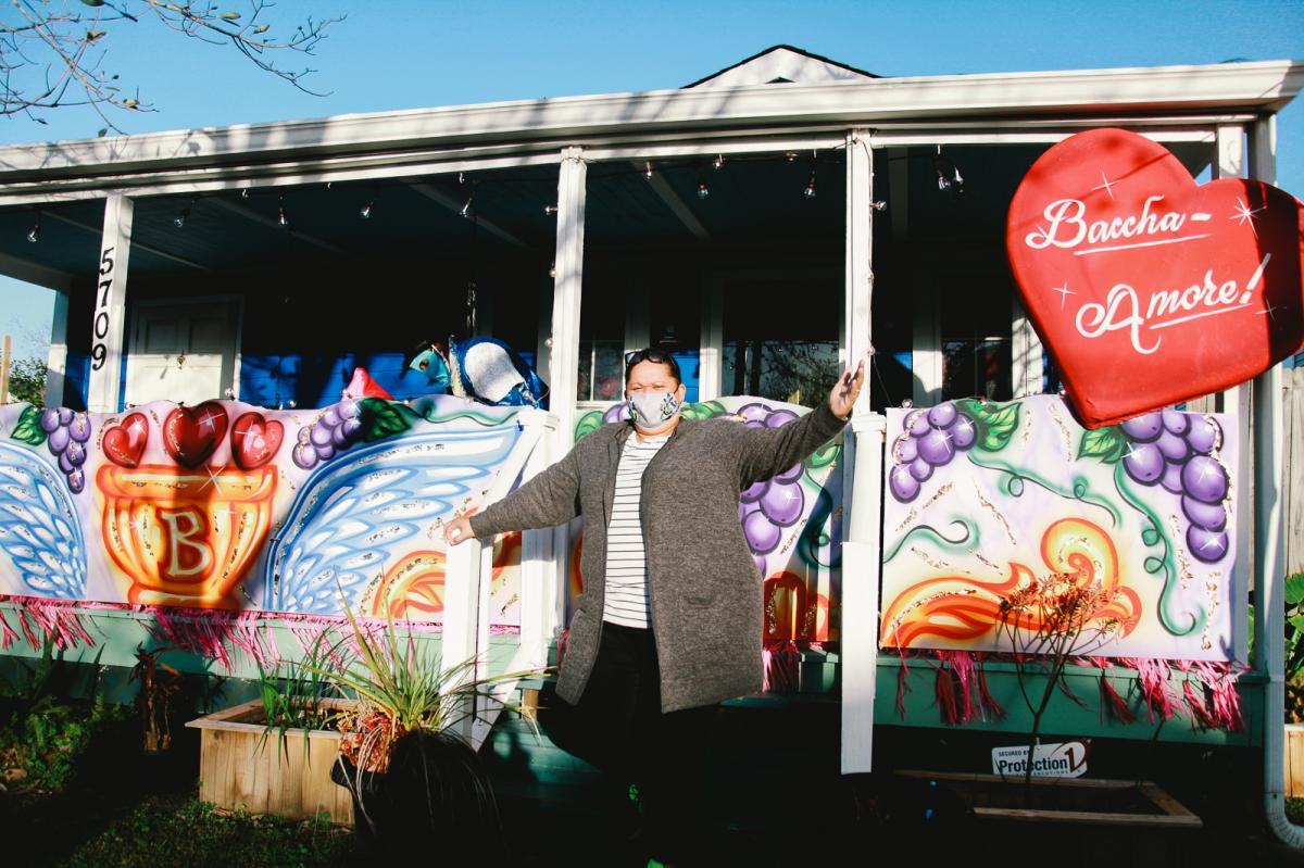 """Inez Pierre, of Crescent City Artists, stands in front of her family's home. It's one of 63 house floats created by the family's business. """"All we want to do is make people happy, make people smile."""""""