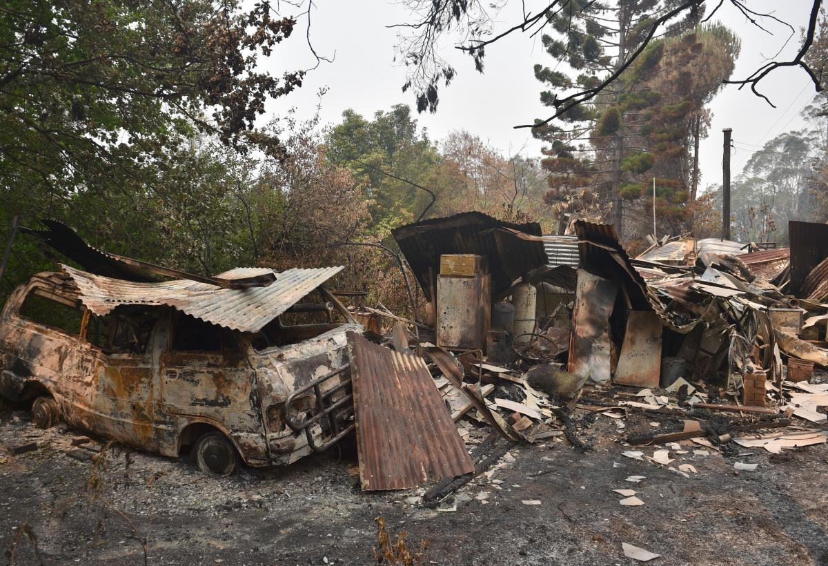 A house and van are seen destroyed after bushfires ravaged the town of Bilpin, 70 km west of Sydney on December 29, 2019.