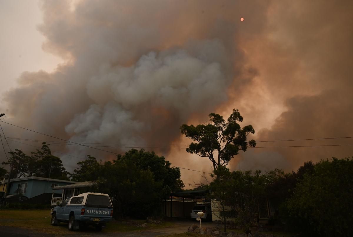 A fire burns from back burning as firefighters prepare ahead of a fire front in the New South Wales town of Jerrawangala on January 1, 2020. A major operation to reach thousands of people stranded in fire-ravaged seaside towns was under way in Australia o