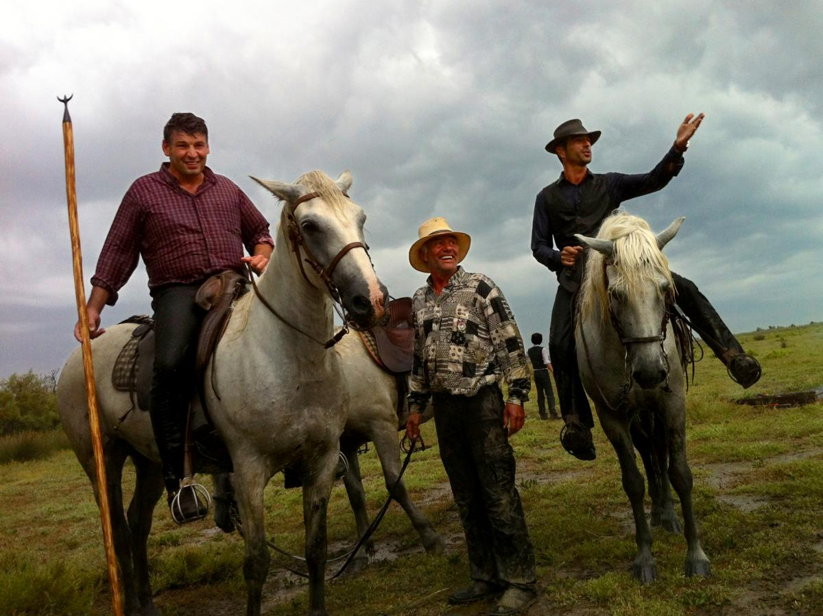 Gardiens, or cowboys, Renaud Vinuesa (on horseback, left) and Olivier Terroux (on horseback, right) are out in the Camargue region of southern France for a branding, or la ferrade, with their tridents.