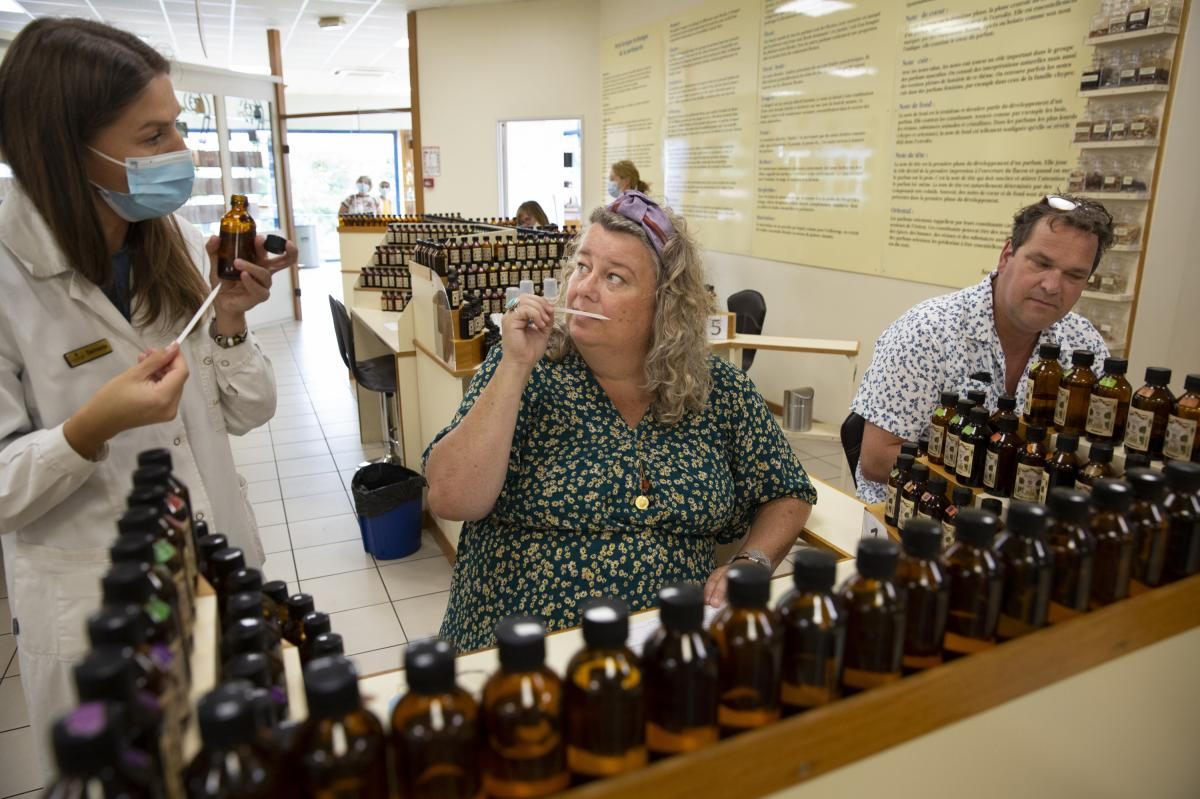 Paul Lokker, 45, and Mariska Lokker, 49, tourists from the Netherlands, try their hand at creating their own fragrance during a workshop at the Galimard Studio des Fragrances in Grasse.