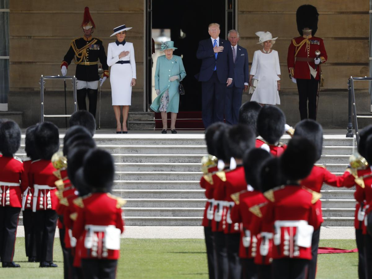 Queen Elizabeth II, President Trump, first lady Melania Trump, Prince Charles and Camilla, Duchess of Cornwall, listen to the U.S. national anthem during a ceremonial welcome in the garden of Buckingham Palace in London on Monday.
