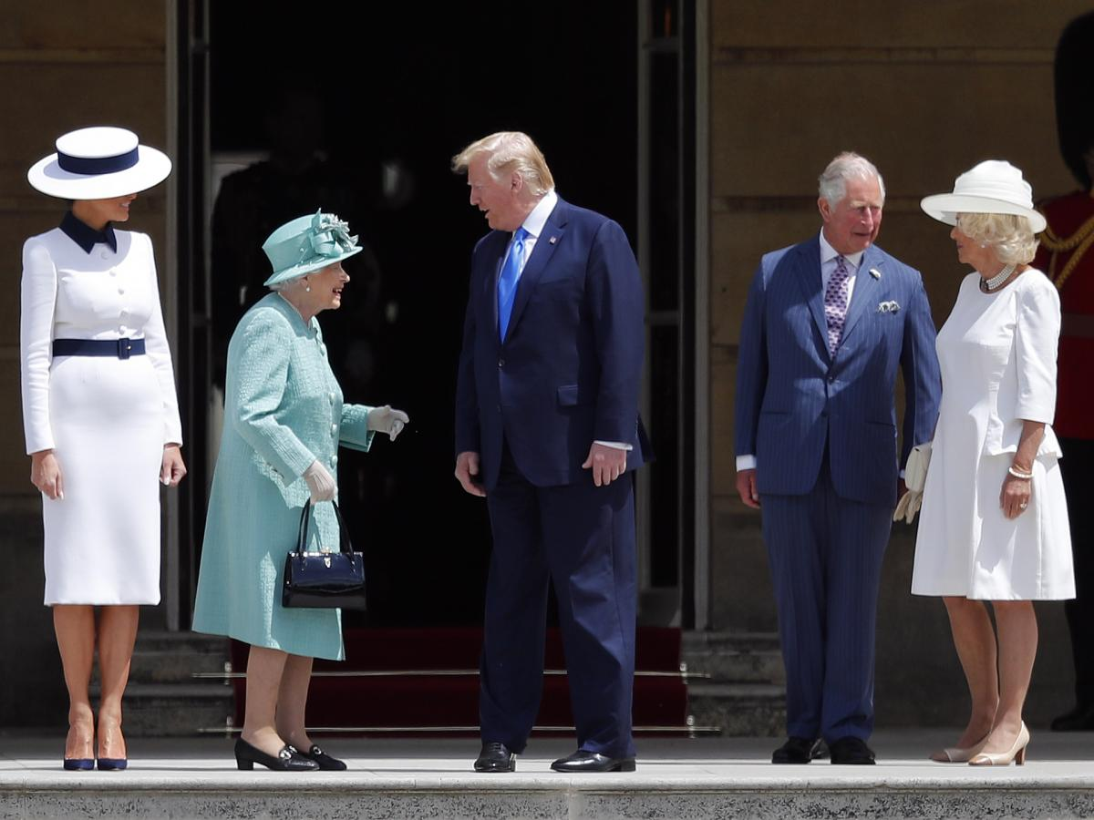 Queen Elizabeth II greets President Trump and first lady Melania Trump with Britain's Prince Charles and Camilla, Duchess of Cornwall, during a ceremonial welcome in the garden of Buckingham Palace in London, on Monday.