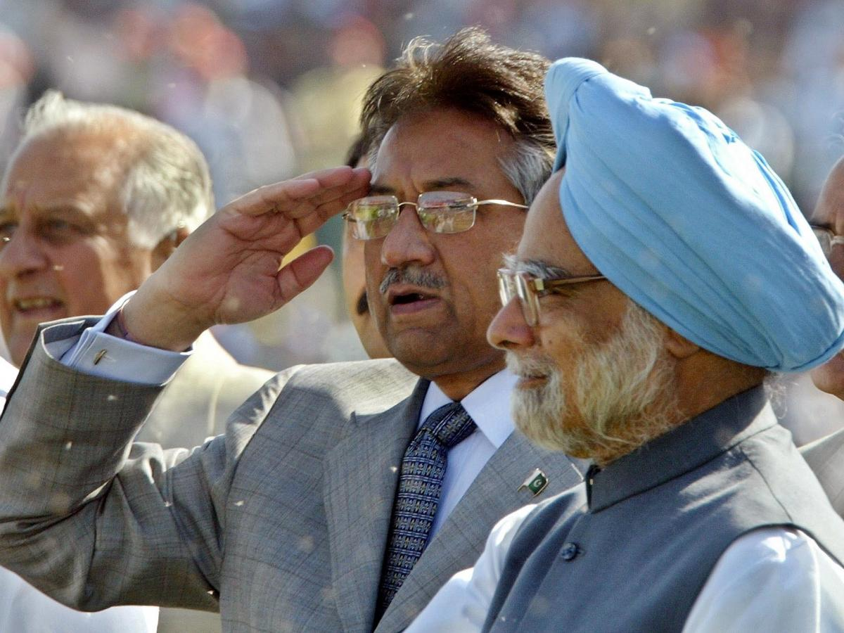 In 2005, Pakistan's President Gen. Pervez Musharraf salutes spectators as Indian Prime Minister Manmohan Singh (right) looks on during a cricket match between India and Pakistan in New Delhi. The two leaders later held talks on how to end decades-old host