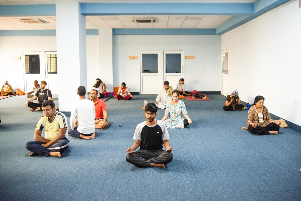 Yoga classes at the headquarters of Patanjali, Baba Ramdev's business that manufactures Ayurveda wellness products based on ancient Hindu healing practices.