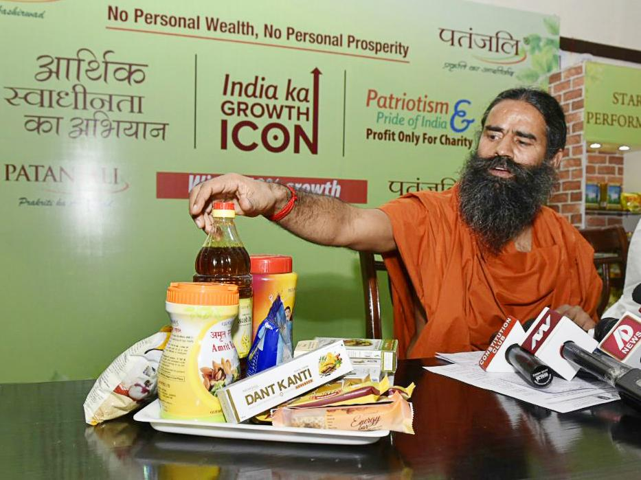 Baba Ramdev shows some Patanjali products in 2016 in New Delhi.