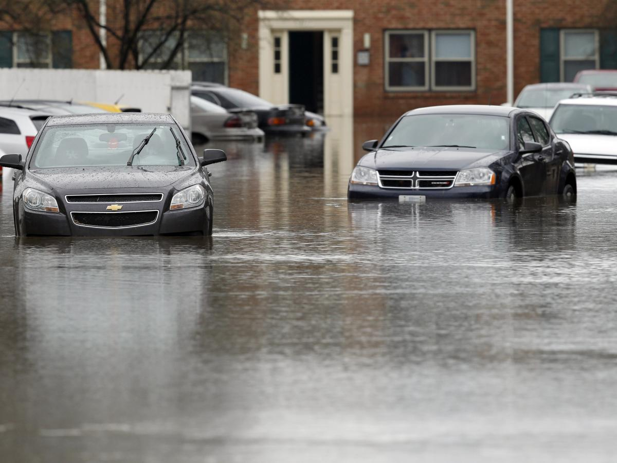 Vehicles sit in high water after heavy rains caused by the flooding in north and central Kentucky.