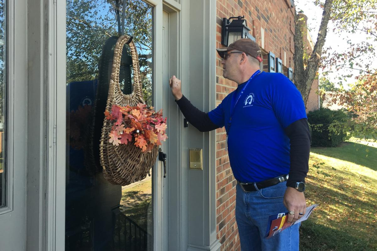Volunteer Patrick Hall in Lexington, Ky., knocks on a door for Bevin on behalf of the Susan B. Anthony List, an anti-abortion organization.