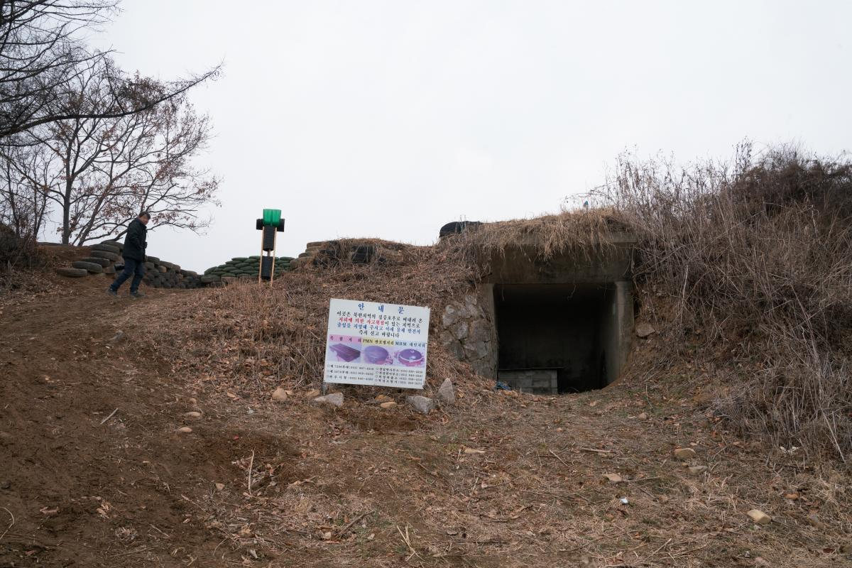Kim Seung-ho walks past a bunker near the Imjin River in an unrestricted area outside South Korea's Civilian Control Zone.