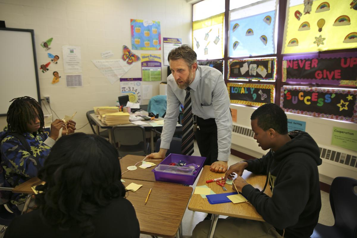 Crescent Leadership Academy's principal, Nicholas Dean, co-teaches a class.