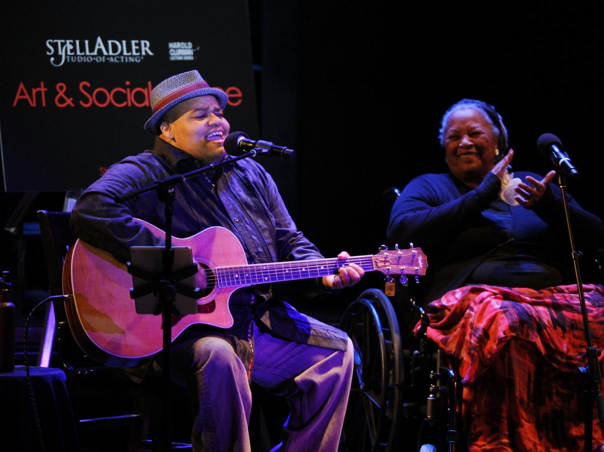 As Toni Morrison looks on, Toshi Reagon performs during an Art & Social Activism discussion on Broadway in June 2016.