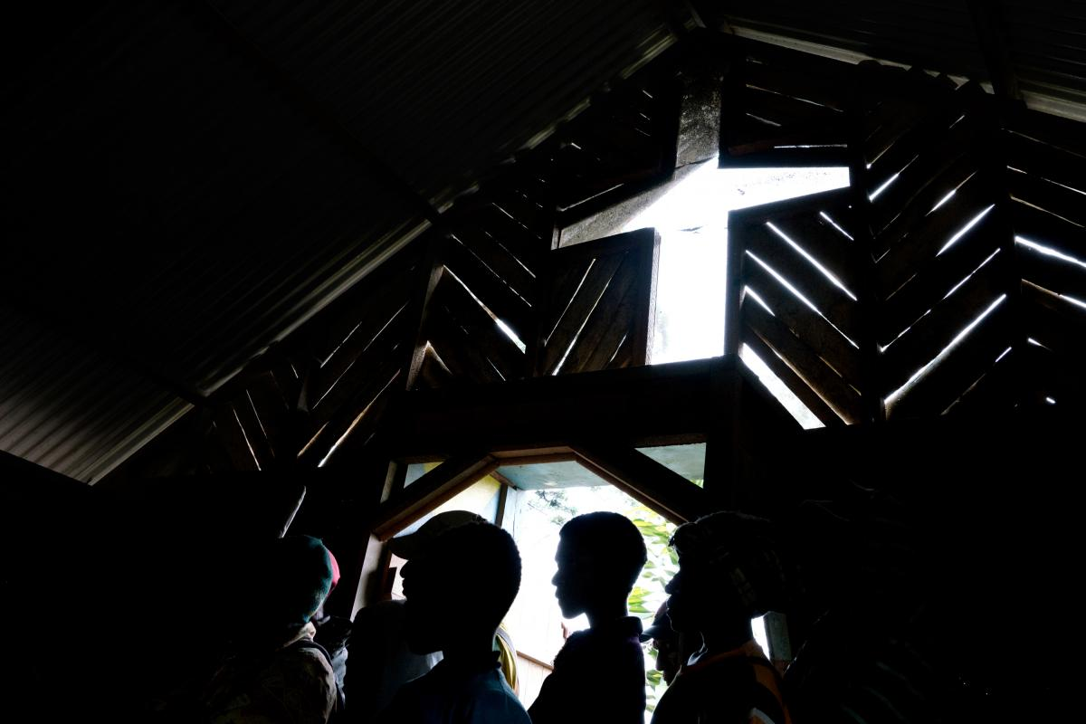 People crowd into a church in the town of Henganofi in the Eastern Highlands of Papua New Guinea for a meeting to end violence resulting from sorcery accusations. In the Eastern Highlands, the accusation of sorcery is a vigilante's rallying cry. Nationall