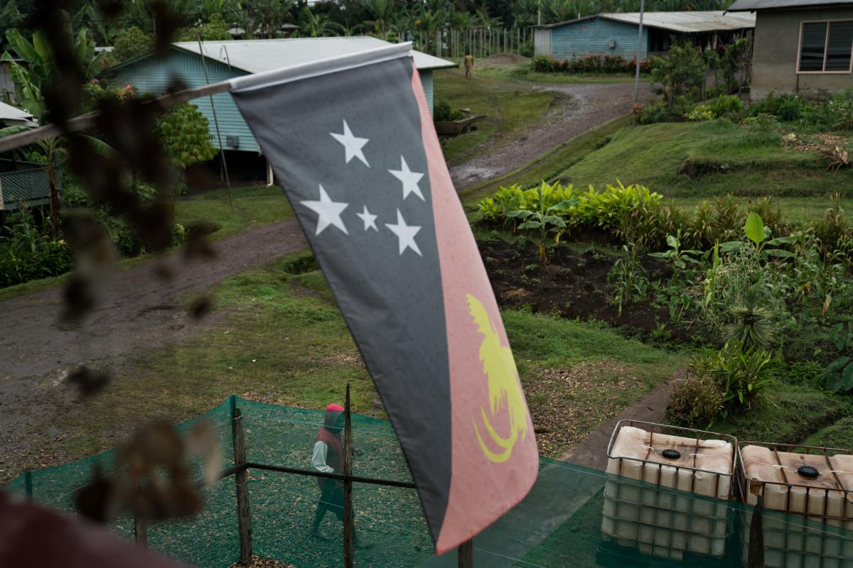 A man walks outside a safe house in Goroka, the capital of Papua New Guinea's Eastern Highlands Province. People fleeing sorcery accusations sometimes seek shelter here.