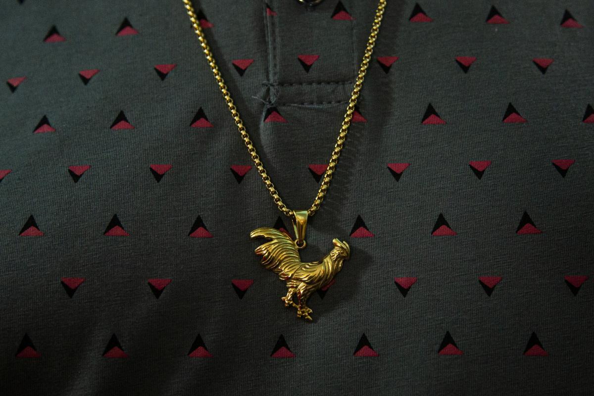 A cockfighter's necklace at the Gallera Borinquén.