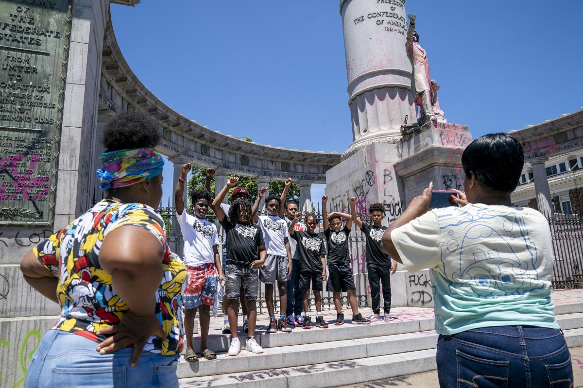 Families gather at the Jefferson Davis Memorial in Richmond, Va., on June 7, following a week of unrest in the U.S. against police brutality and racism in policing.