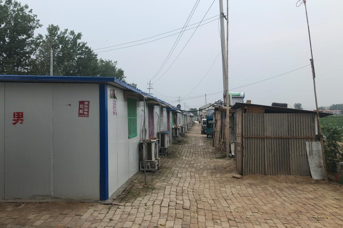 About 40 residents whose houses were demolished in Hongchuancun, or Red Boat Village, now live in these plastic and tin shacks built by the local government.